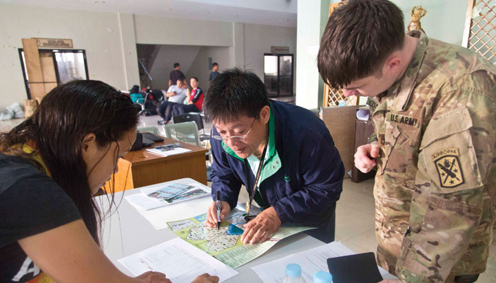 Mappers review their materials in the Philippines.